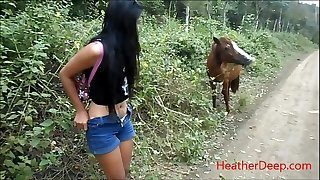 HD pissing next to horse in jungle